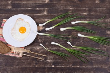 Egg, chives and black plate look like sperm competition